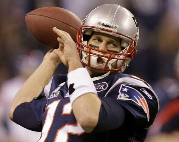 New England Patriots quarterback Tom Brady warms up