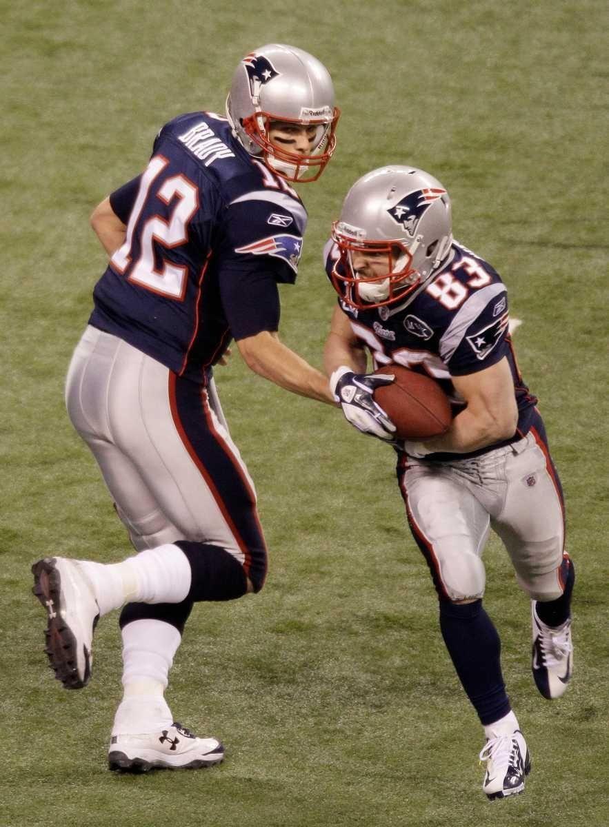 New England Patriots quarterback Tom Brady hands the