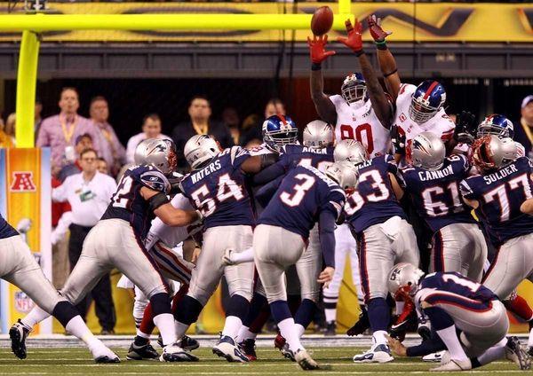 Stephen Gostkowski of the New England Patriots kicks