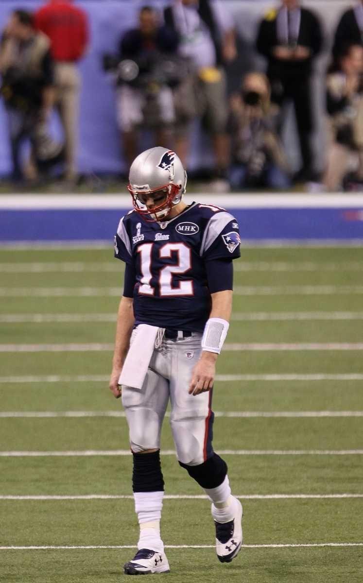 Tom Brady of the New England Patriots walks