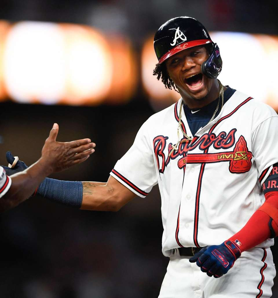 Atlanta Braves' Ronald Acuna Jr. celebrates at first