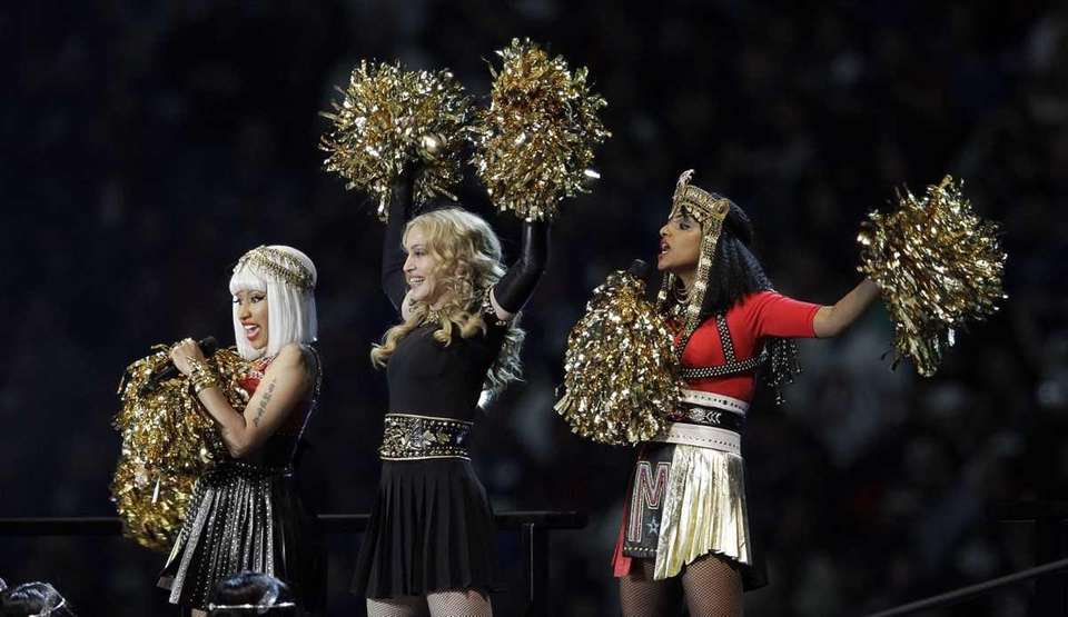 Madonna, center, performs with Nicki Minaj, left, and