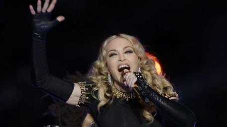Madonna performs during halftime of the NFL Super