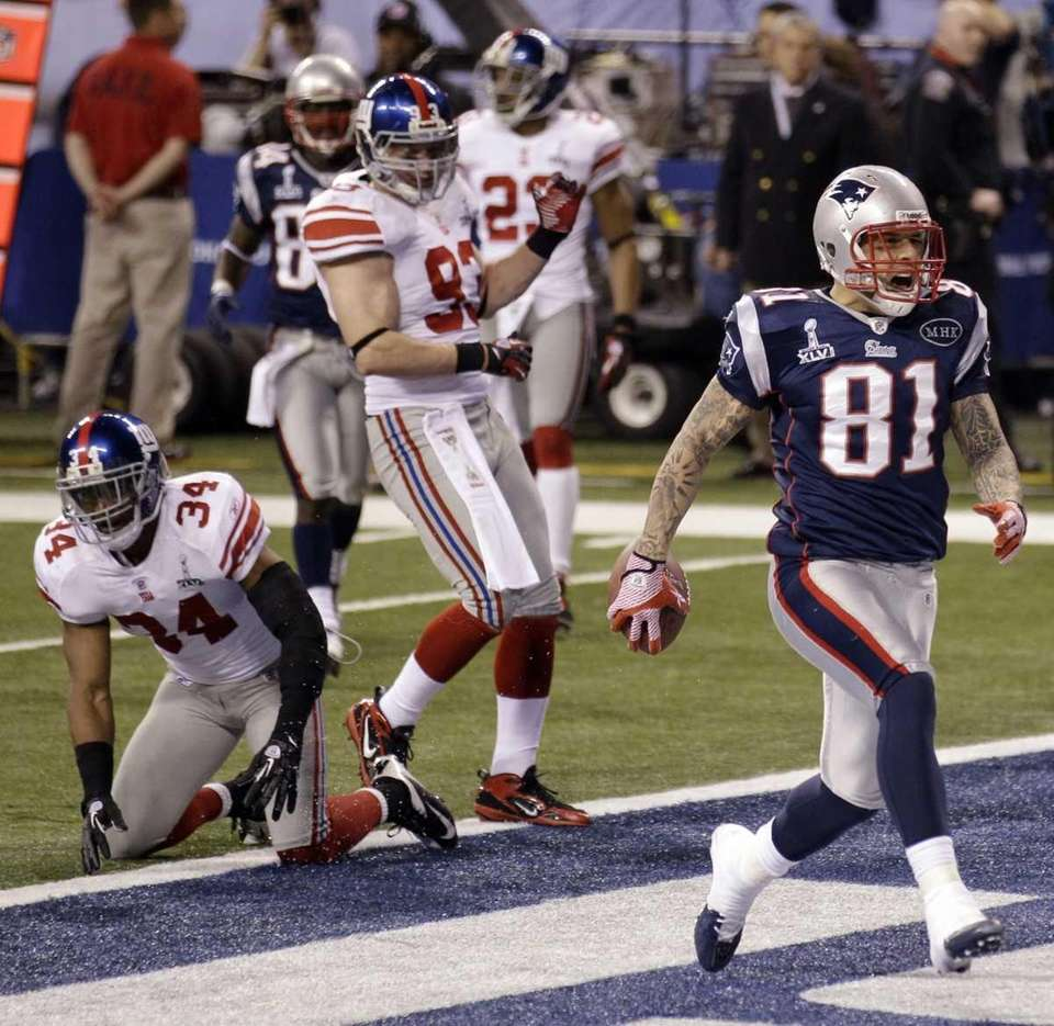New England Patriots tight end Aaron Hernandez celebrates