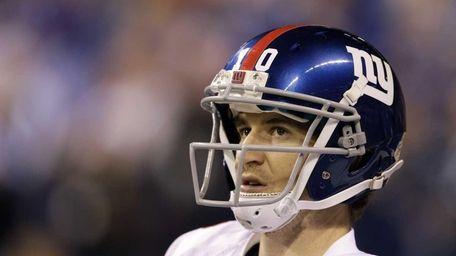 New York Giants quarterback Eli Manning looks on