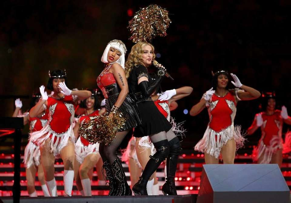 Singer Madonna performs with Nicki Minaj during the