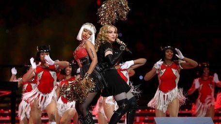Singer Madonna performs with Nicki Minaj during the