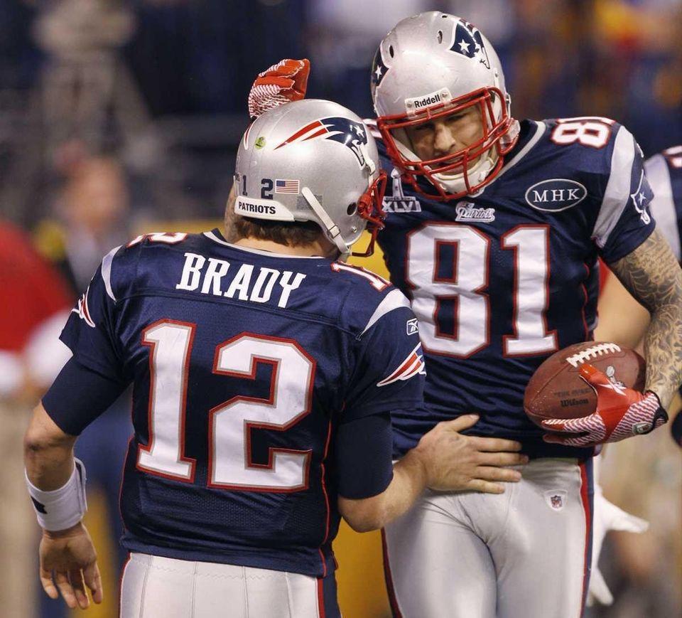 New England Patriots quarterback Tom Brady (12) congratulates