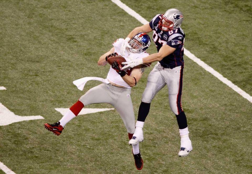 Chase Blackburn of the New York Giants intercepts