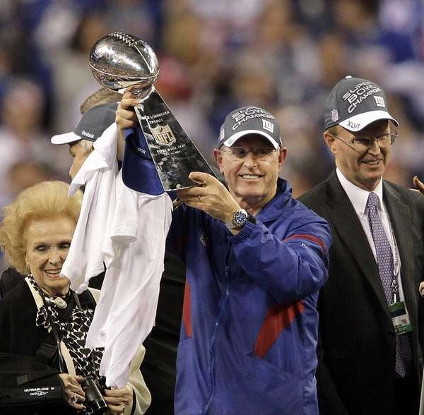 New York Giants head coach Tom Coughlin holds