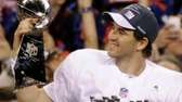 New York Giants quarterback Eli Manning holds the