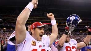 Giants quarterback Eli Manning reacts after watching the