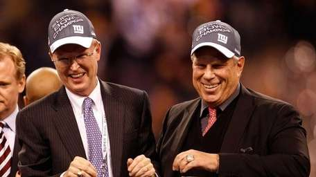 Co-Owners John Mara and Steve Tisch celebrate after