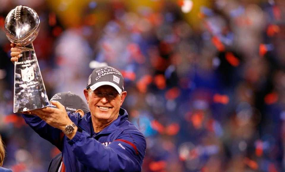 Giants head coach Tom Coughlin poses with the