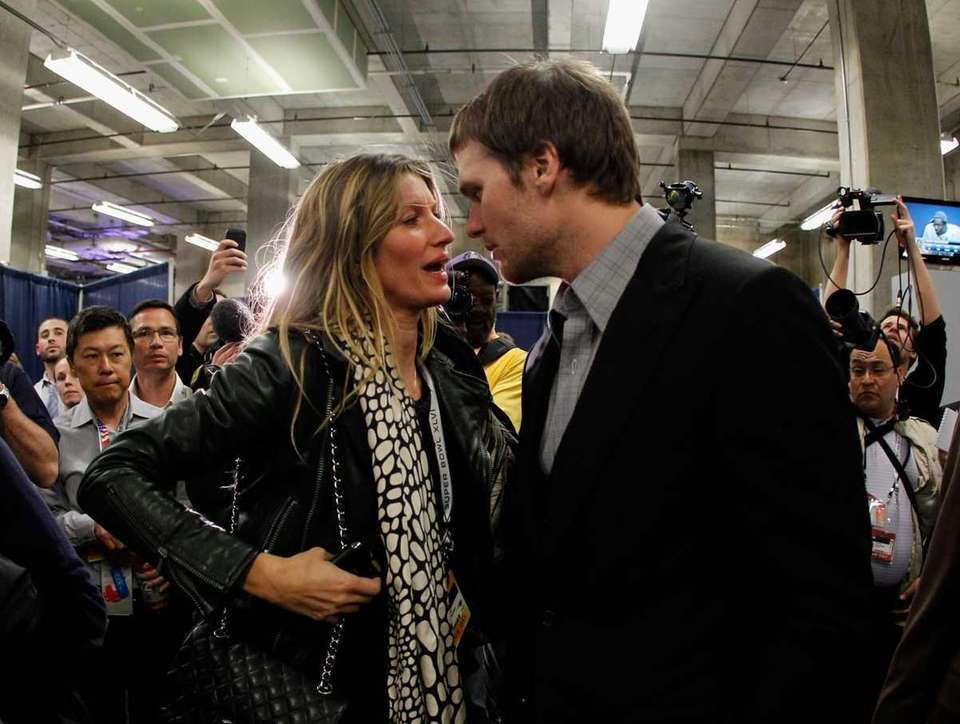 Patriots quarterback Tom Brady chats with his wife,