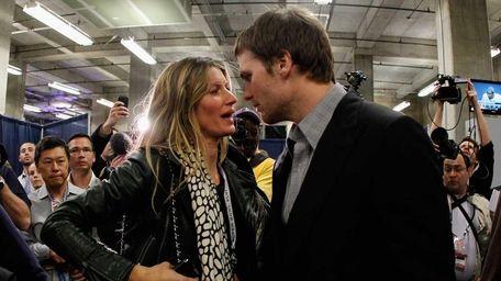 Patriots quarterback Tom Brady chats with his wife,