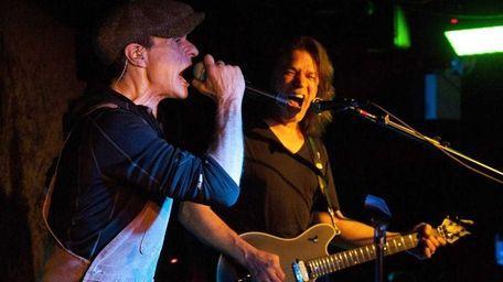 Van Halen members David Lee Roth, left, and