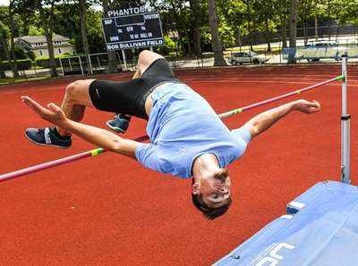 Jack Flood practices the high jump at the