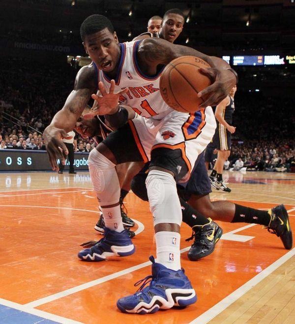 Iman Shumpert of the New York Knicks grabs