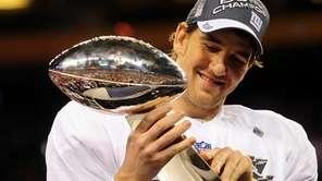 Giants quarterback Eli Manning holds the NFL's VInce