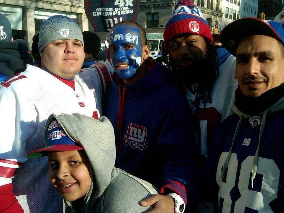 Ray Cedeno, center, of Brooklyn wears G-men blue