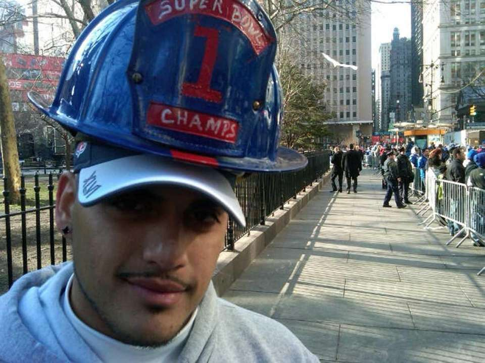 Micheal Belefonte, a firefighter from Piscataway, N.J., shows