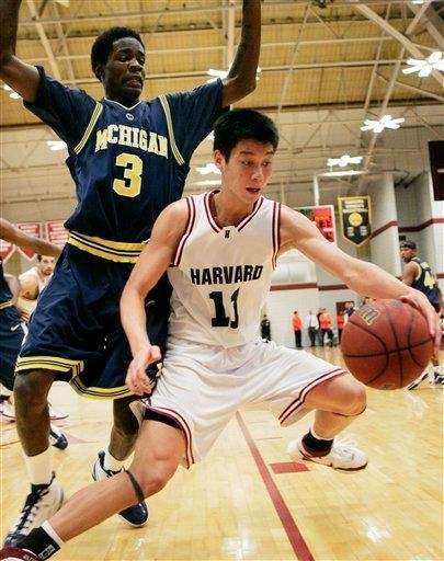 Harvard's Jeremy Lin keeps the ball away from