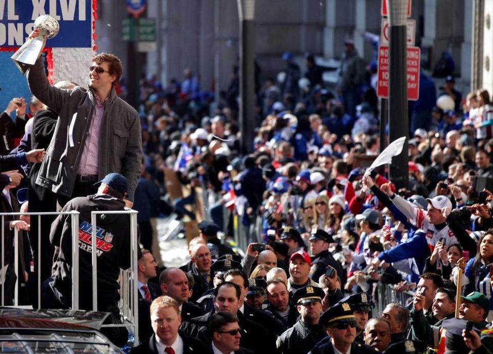 Giant MVP Eli Manning holds up the Lombardi