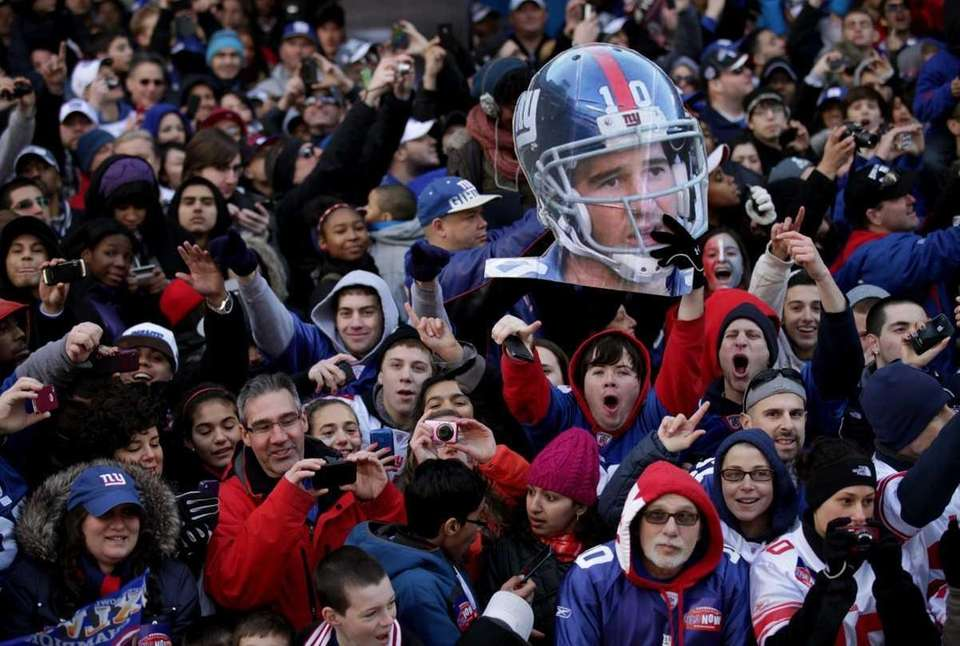 Giant MVP Eli Manning is celebrated by fans