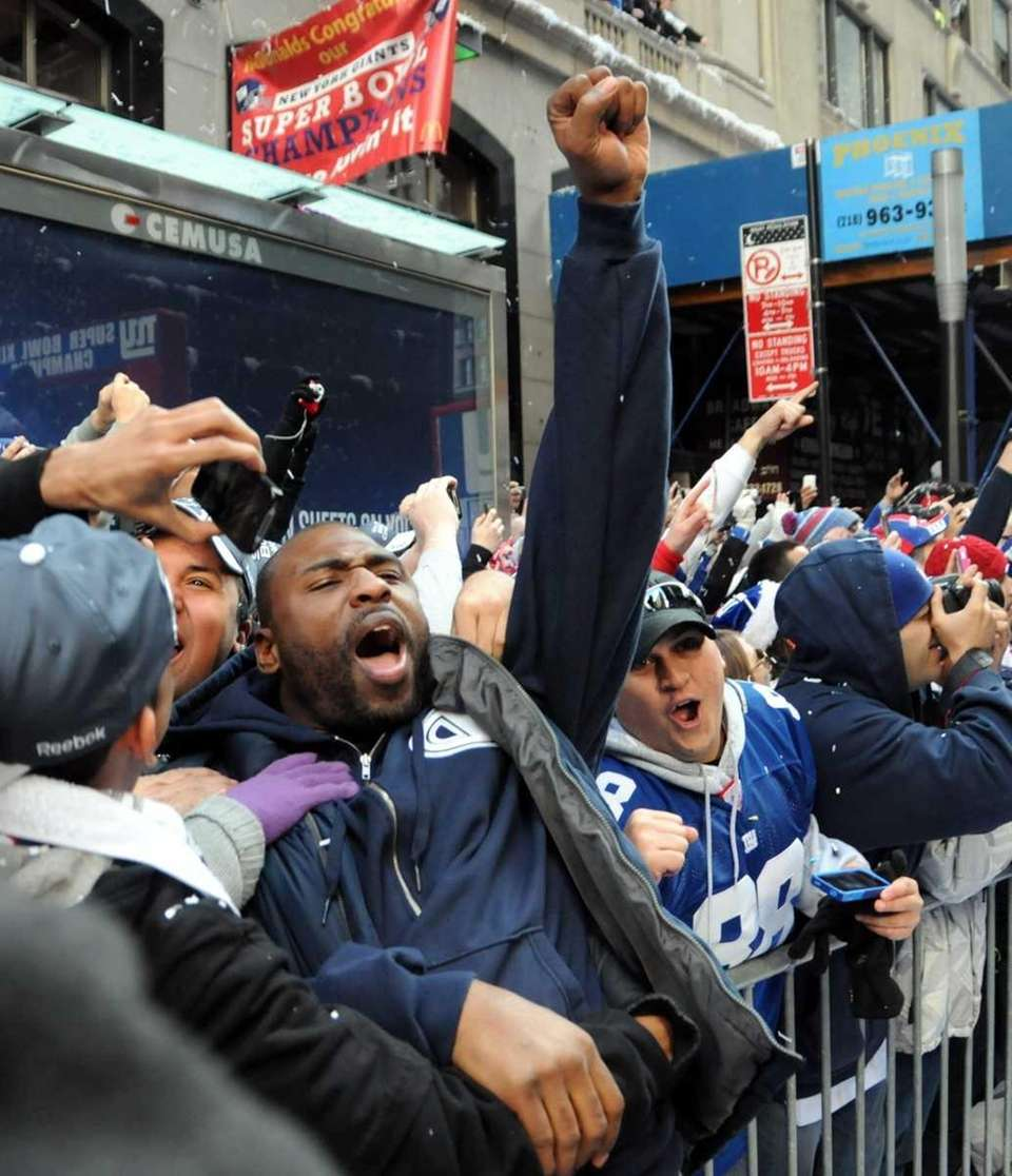 Giants running back Brandon Jacobs jumps into crowd