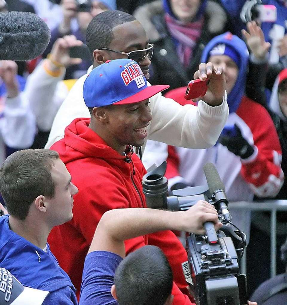 Victor Cruz on a float during the Giants'