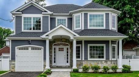 This Manhasset Colonial is listed for $1.58 million.