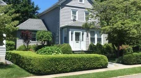 This Manhasset Colonial is listed for $868,000.