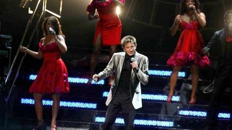 Barry Manilow performs during his