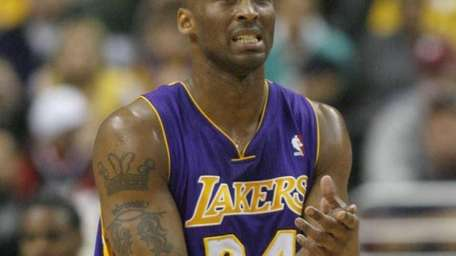 Los Angeles Lakers' Kobe Bryant (24) reacts after