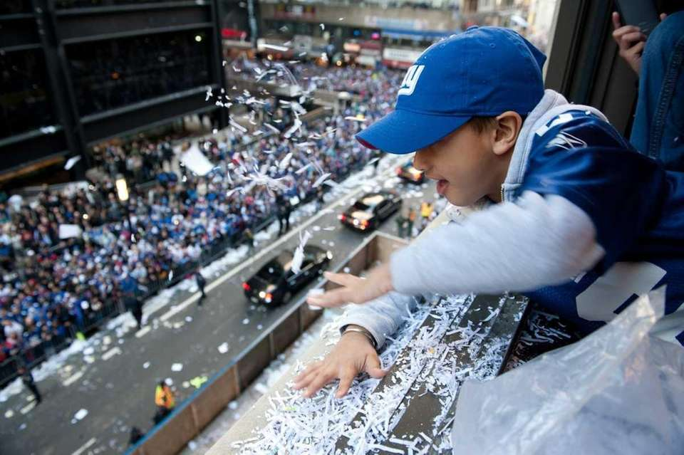 A small Giants fan leans out of an