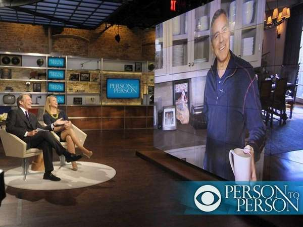Co-anchors Lara Logan and Charlie Rose interview George