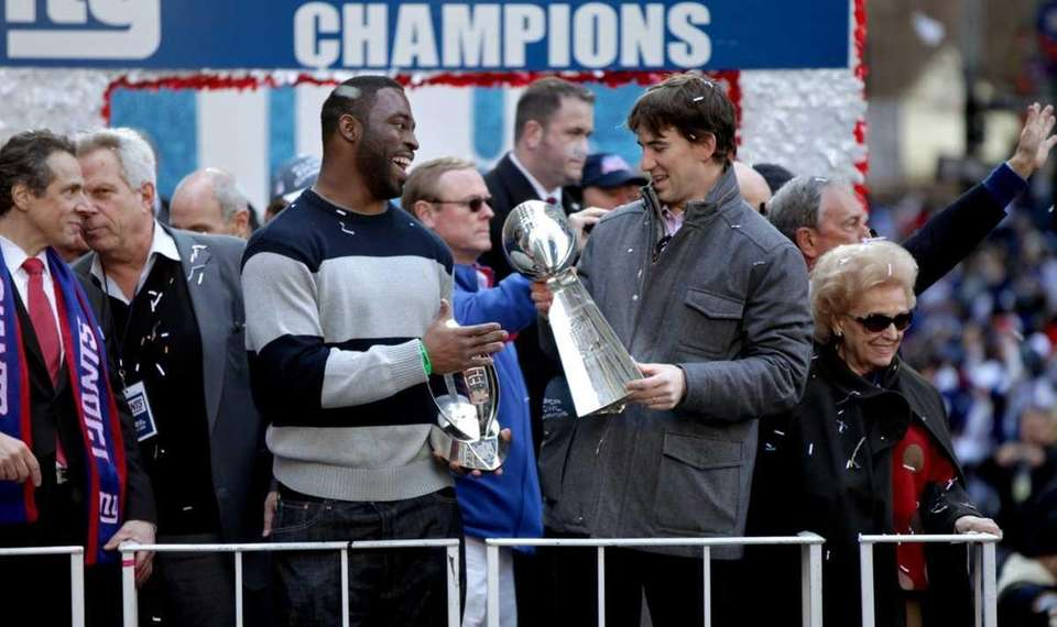 Justin Tuck smiles as he and Eli Manning