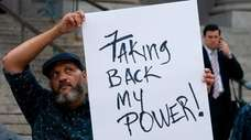 A sex-abuse survivor joins protesters Wednesday to call