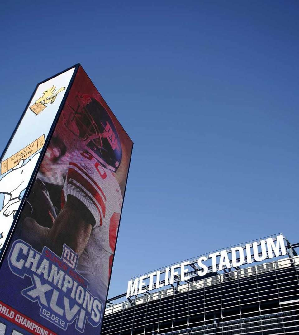 Screens celebrate the New York Giants' Super Bowl