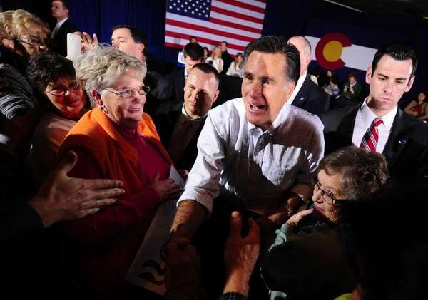 Republican presidential hopeful Mitt Romney greets supporters during