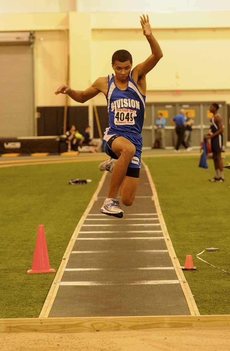 Division's Ryan Billian competes in the long jump