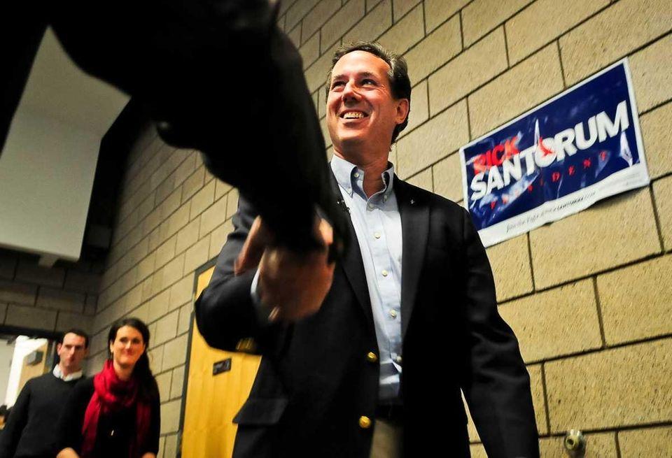 Republican presidential candidate Rick Santorum arrives at a