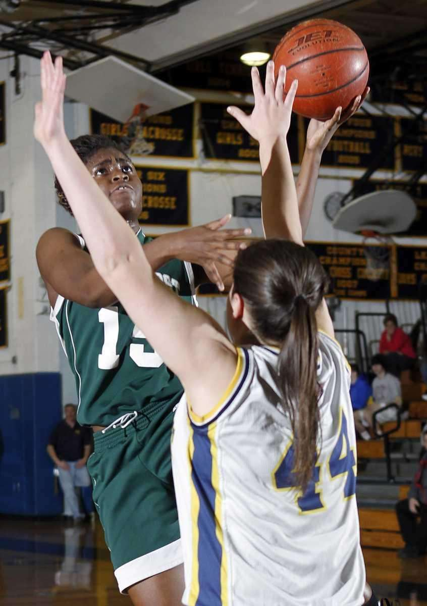 Lindenhurst's Valerie Oyakilome (15) with the layup over