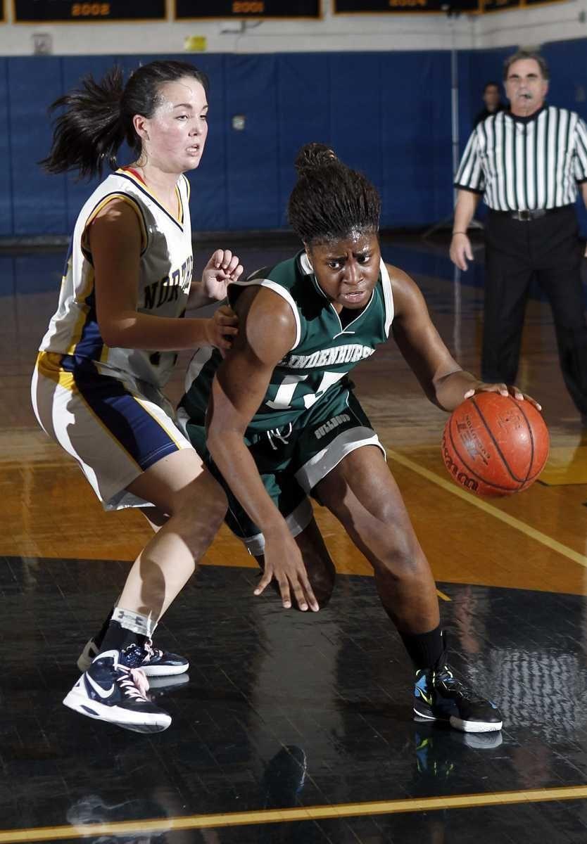 Lindenhurst's Valerie Oyakilome (15) drives from the foul