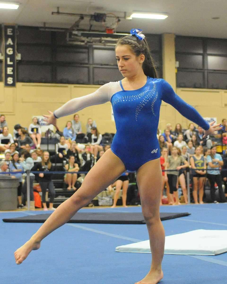 Plainview's Melissa Kropf performs her floor routine during