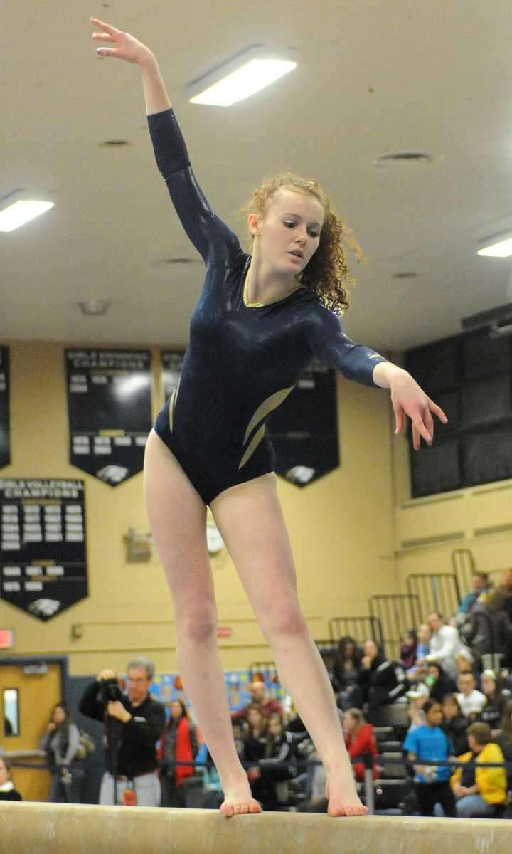 Kathleen Wall of Massapequa performs her balance beam