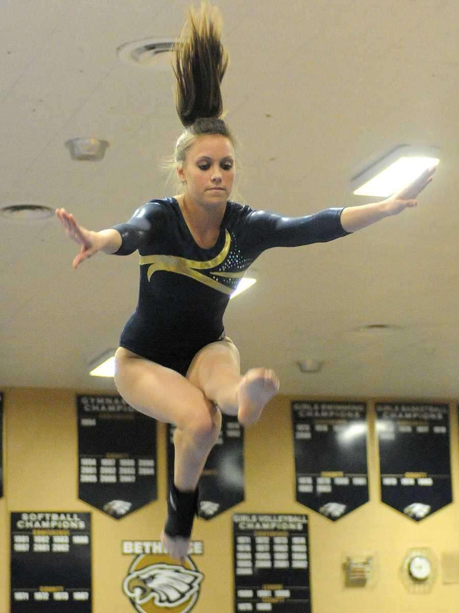 Bethpage senior Erin Roach performs her balance beam