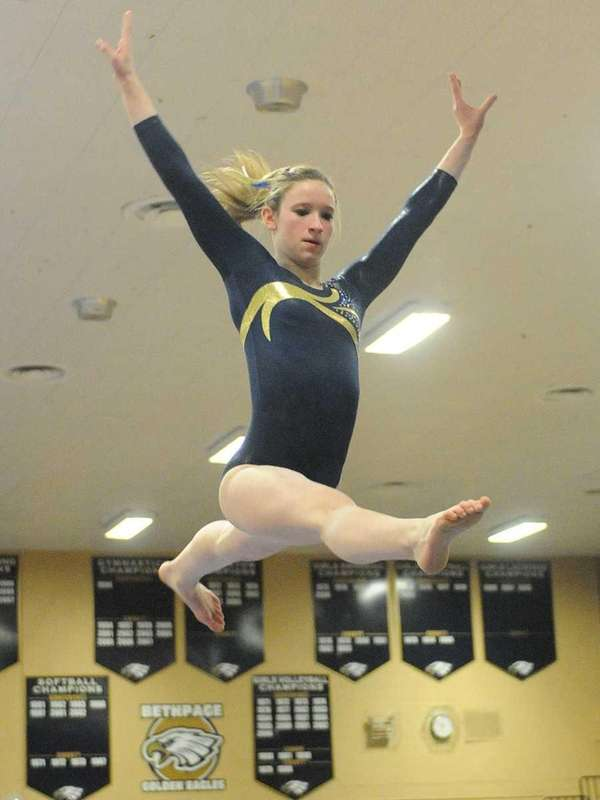 Alexis Fraher of Bethpage performs her balance beam