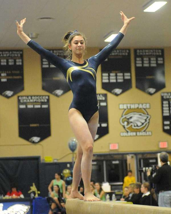 Sarah Ciresi of Bethpage performs her balance beam